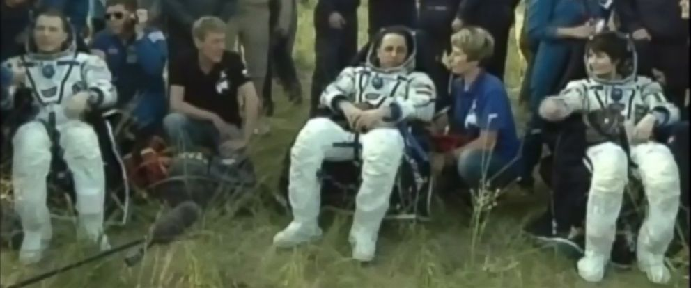 PHOTO: A screen grab from a NASA TV video of astronauts Terry Virts, Anton Shkaplerov and Samantha Cristoforetti after landing the Soyuz TMA-15M spacecraft in Kazakhstan on June 11, 2015.