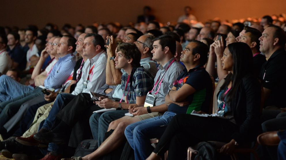 Cyber security researchers at Black Hat USA 2015 watch a presentation on vehicle hacking Aug.5, 2015.