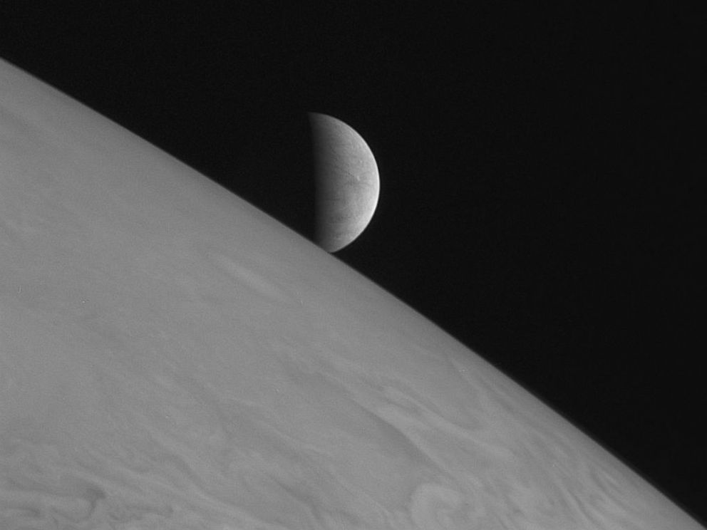 PHOTO: New Horizons took this image of the icy moon Europa rising above Jupiters cloud tops with its Long Range Reconnaissance Imager (LORRI)on Feb. 28, 2007.