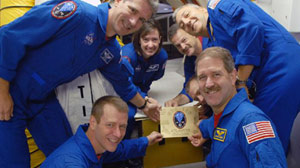 STS-125 Crew at the Hatch