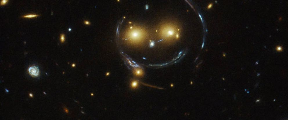 """PHOTO: In the center of this image is the galaxy cluster SDSS J1038+4849, which appears to be """"smiling."""""""