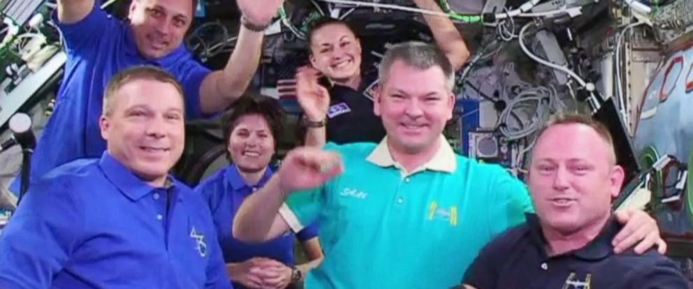 PHOTO: Commander Barry Wilmore hands over command of the International Space Station to Terry Virts.