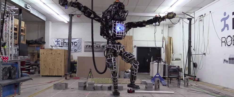 "PHOTO: A robot developed by Boston Dynamics stands on a pile of cinder blocks and mimics a pose from the movie ""Karate Kid"" in a video uploaded to YouTube on Nov. 8, 2014 titled, ""20141108 115244 Atlas KarateKid."""