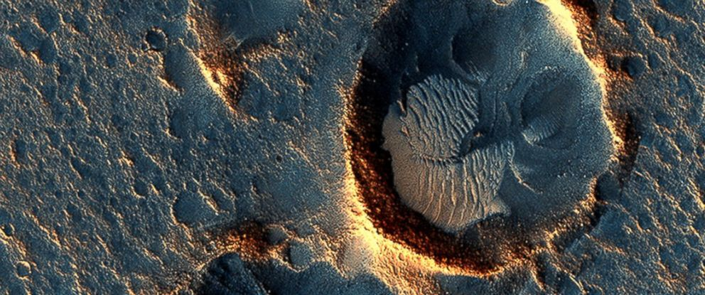 "PHOTO: Images taken by the Mars Reconnaissance Orbiter show where the fictional astronaut in ""The Martian"" would have been stranded."