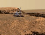"""PHOTO: An artists concept of the Mars Exploration Rover Opportunity atop the """"Cabo Frio"""" promontory on the rim of """"Victoria Crateron Mars is shown to give a sense of scale."""