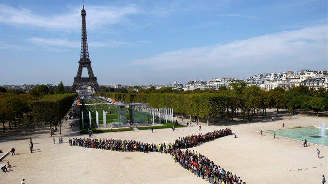 PHOTO:People power rivals the Eifel Tower in Paris, France as residents form a giant wind turbine with their bodies.