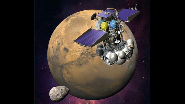 PHOTO: An artists concept of the Phobos-Grunt spacecraft nearing the Martian moon Phobos.