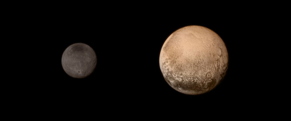 A portrait from the final approach. Pluto and Charon display striking color and brightness contrast in this composite image from July 11, 2015 showing high-resolution black-and-white LORRI images.