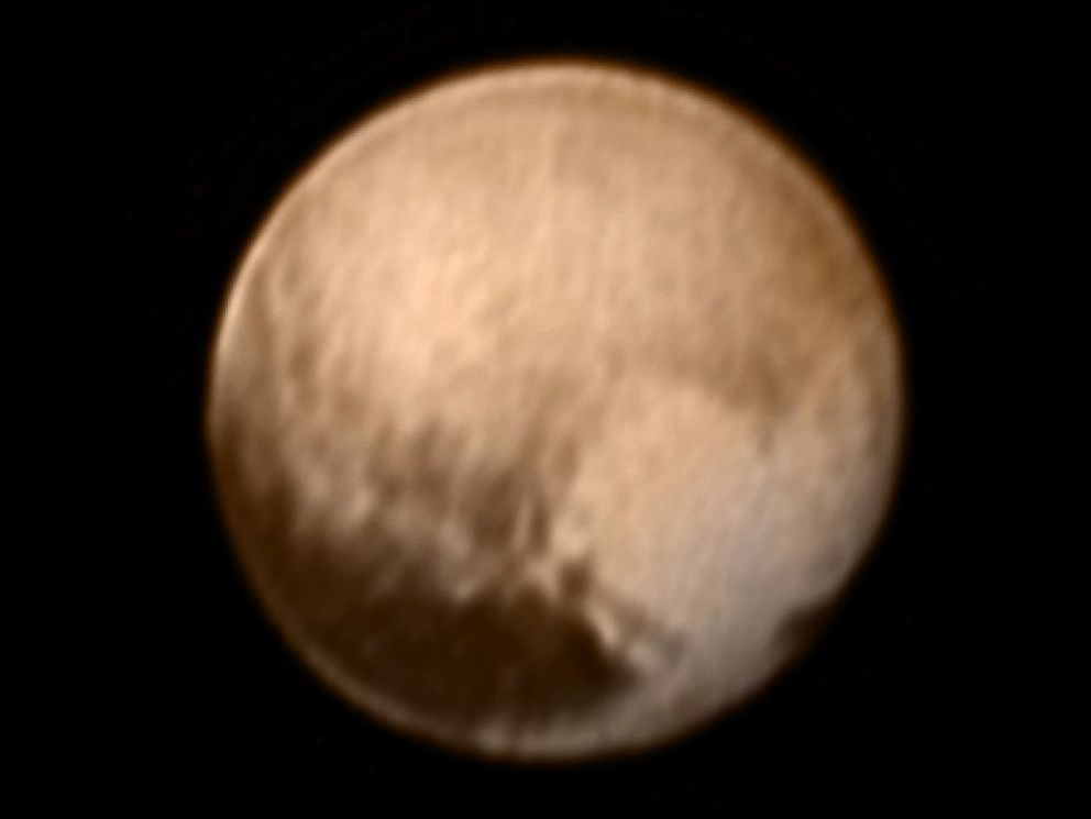 PHOTO: This image of Pluto from New Horizons' Long Range Reconnaissance Imager (LORRI) was received on July 8, 2015 and has been combined with lower-resolution color information from the Ralph instrument.