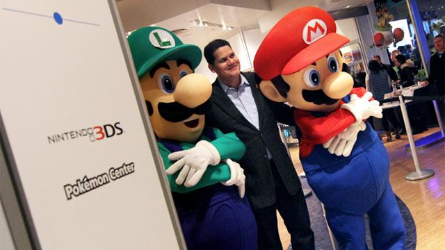 PHOTO:Nintendo of America President Reggie Fils-Aime poses with Mario and Luigi on Wii U launch night.
