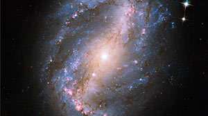 Photo: Hubbles Cosmic Comeback: NASA Releases New Images: The Peoples Telescope Comes Back Online After Major Upgrades