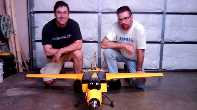 PHOTO:Seen here is Richard Perkins and Mike Tassey with an early Wireless Aerial Surveillance Platform, aka WASP drone airplane model.