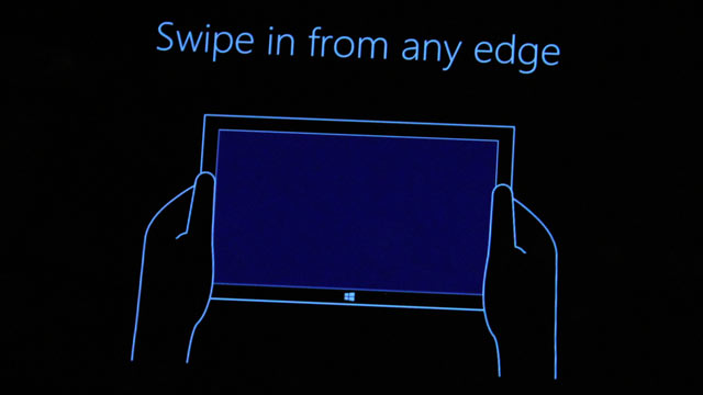PHOTO: A instructional screen that appears before you start using Windows 8.