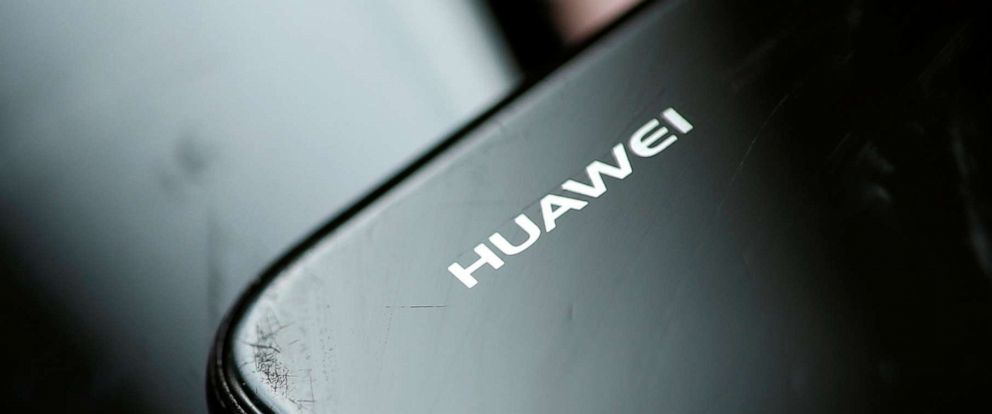 PHOTO: Logo of Huawei is pictured as a worker refurbishes a cell phone at a workshop in Lusignac, France, June 20, 2019.