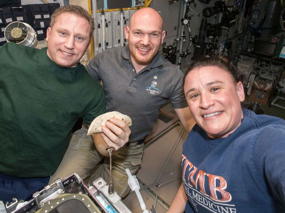 PHOTO: Flight Engineer Serena Aunon-Chancellor takes a group-selfie with Expedition 57 crewmates aboard the International Space Station, flight engineer Sergey Prokopyev and Alexander Gerst, in a photo shared on Nov. 9, 2018.