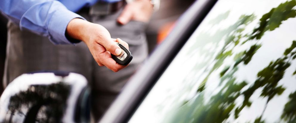 PHOTO: In this undated stock photo, a man unlocks a car door using a key fob.