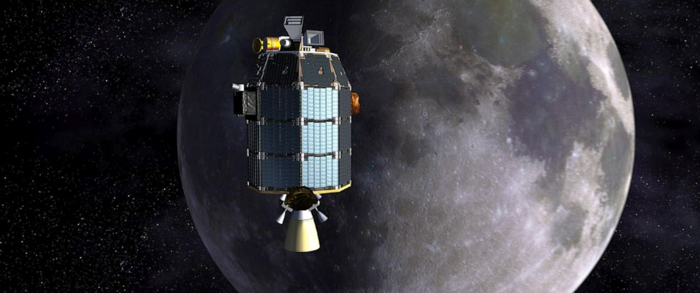 PHOTO: An artists depiction of NASAs Lunar Atmosphere and Dust Environment Explorer (LADEE) observatory as it approaches lunar orbit.