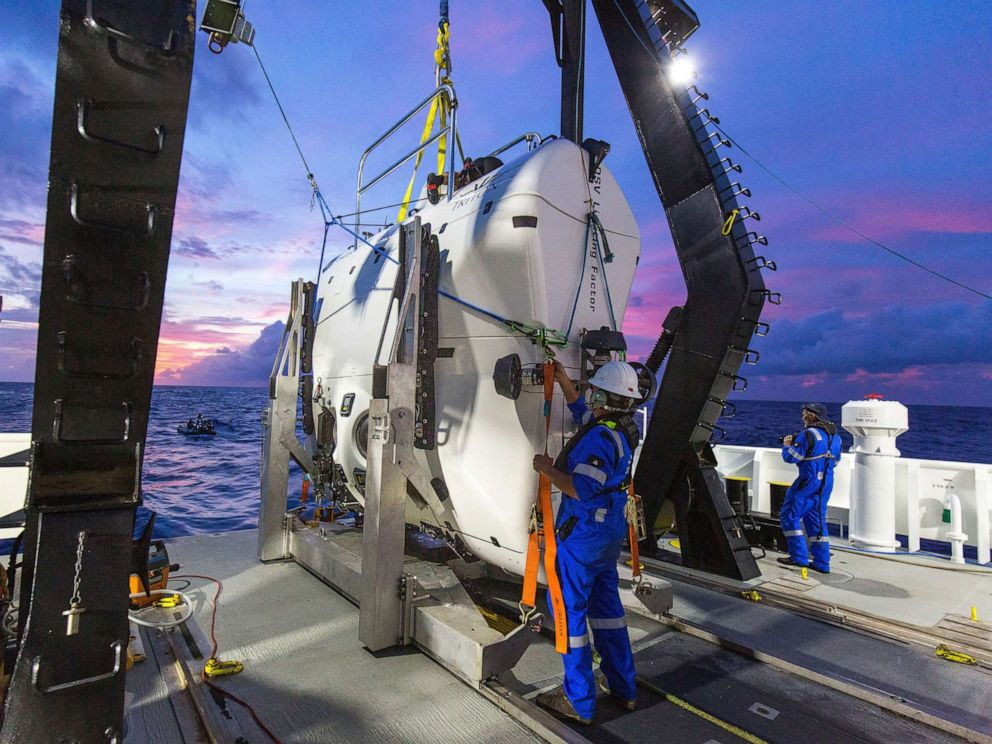 PHOTO: The submarine Limiting Factor is prepared at a drop point above the Mariana Trench.