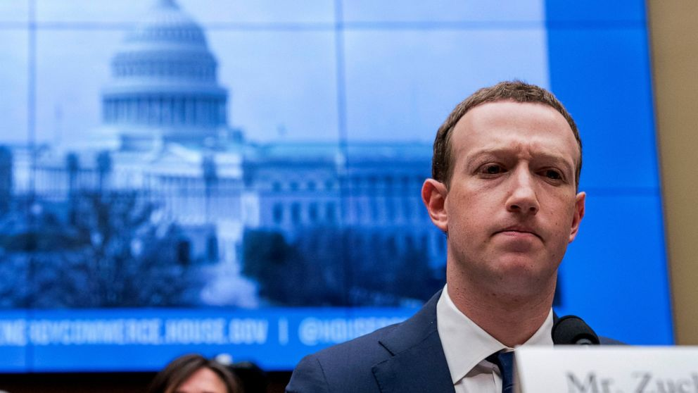 In this April 11, 2018, file photo, Facebook CEO Mark Zuckerberg pauses while testifying before a House Energy and Commerce hearing on Capitol Hill in Washington about the use of Facebook data to target American voters in the 2016 election and data privacy.