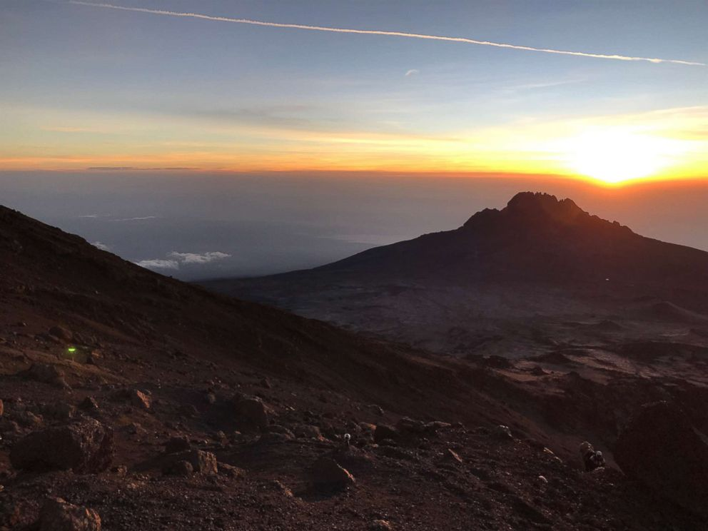 Sunrise is pictured from Gilman's Point at an elevation of 5685 meters, just below the crater at the summit of Mount Kilimanjaro, Tanzania, in February 2019.