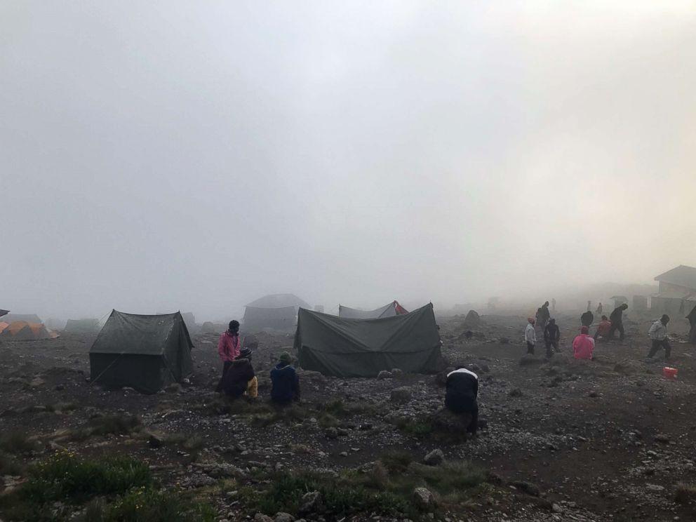 Clouds envelop Karanga Camp at an elevation of 3995 meters on Mount Kilimanjaro, Tanzania, February 2019.