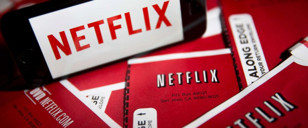 PHOTO: The Netflix Inc. logo is displayed on an Apple Inc. iPhone 5s surrounded by DVD mailers in this arranged photograph in Washington, April 14, 2015.