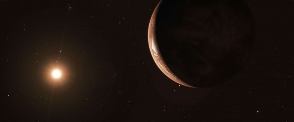 PHOTO: An illustration shows a newly discovered exoplanet at least 3.2 times as large as the Earth rotating Barnards Star, the closest single star to the Sun.