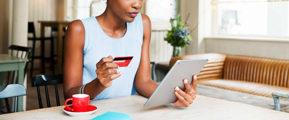 PHOTO: A woman is pictured doing online shopping with her tablet in this undated stock photo.