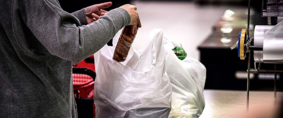 PHOTO: In this picture taken on Nov. 7, 2018, a woman packs her shopping into a plastic bag in a supermarket in Chiba, Japan.