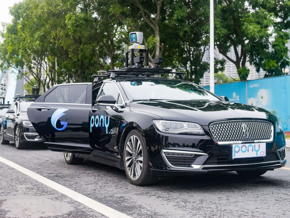 PHOTO: Pony.ai self-driving cars run along a road during a trial run, Feb. 2, 2018, in Guangzhou, China.