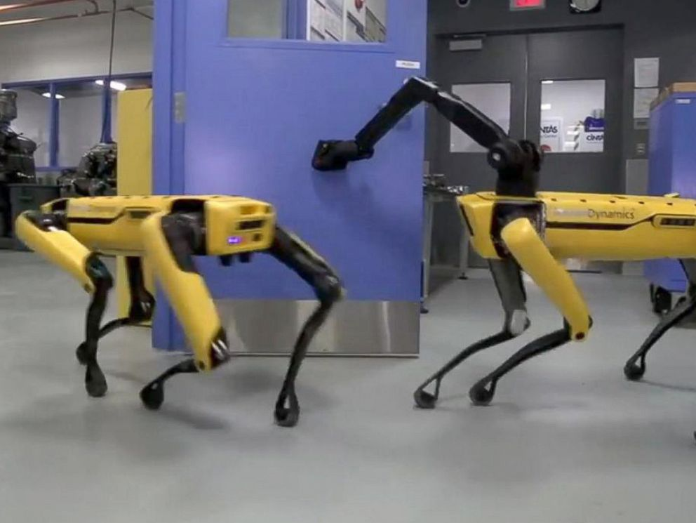 Boston Dynamics The SpotMini robot made by Boston Dynamics opens a door using an arm attachment in You Tube video