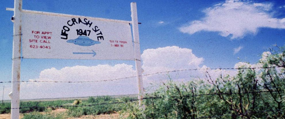PHOTO: A sign off route U.S. 285, north of Roswell, New Mexico, points west to the alleged 1947 crash site of a flying saucer on the Corn Ranch, June 20 1997.
