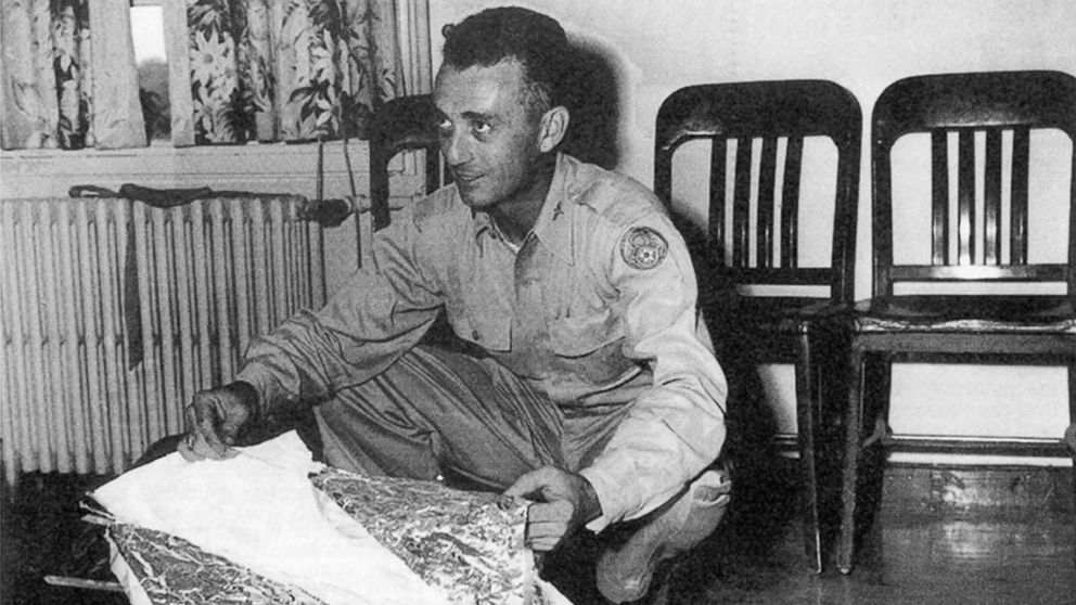 Major Jesse Marcel from the Roswell Army Air Field with debris found 75 miles north west of Roswell, N.M., in June 1947.