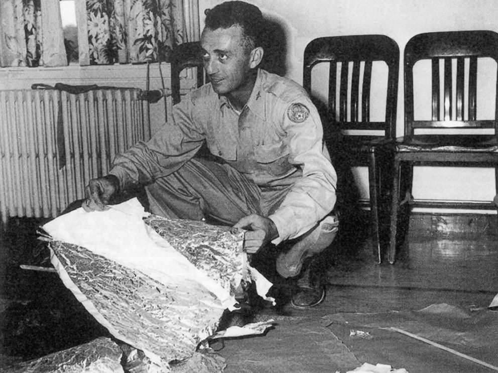 PHOTO: Major Jesse Marcel from the Roswell Army Air Field with debris found 75 miles north west of Roswell, N.M., in June 1947.