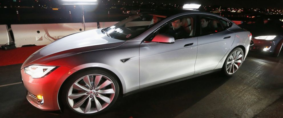 PHOTO: New all-wheel-drive versions of the Tesla Model S car are lined up for test drives in Hawthorne, Calif. on Oct. 9, 2014.