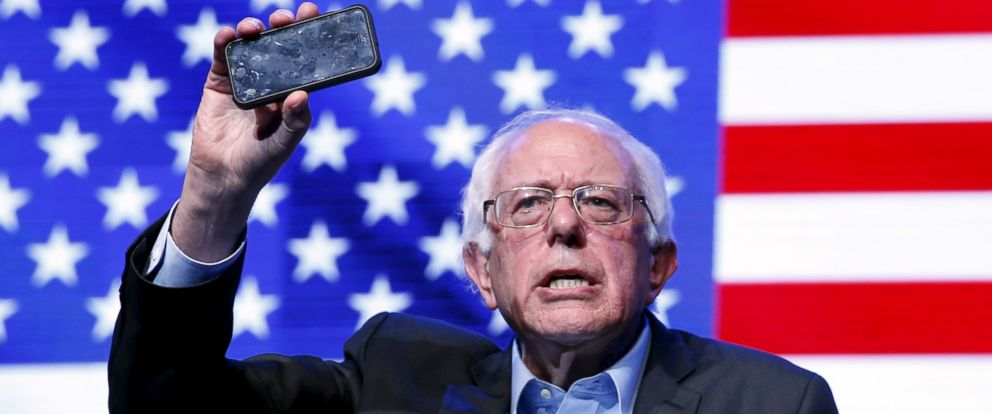 PHOTO: Bernie Sanders holds up a phone while talking about citizens recording police abuses at a rally in Hollywood, Calif., Oct. 14, 2015.