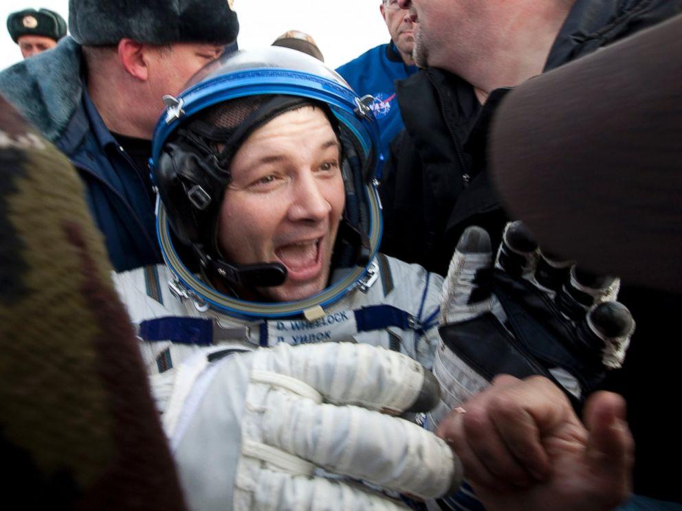 PHOTO: U.S. astronaut Douglas Wheelock reacts after landing near the town of Arkalyk in northern Kazakhstan Nov. 26, 2010.