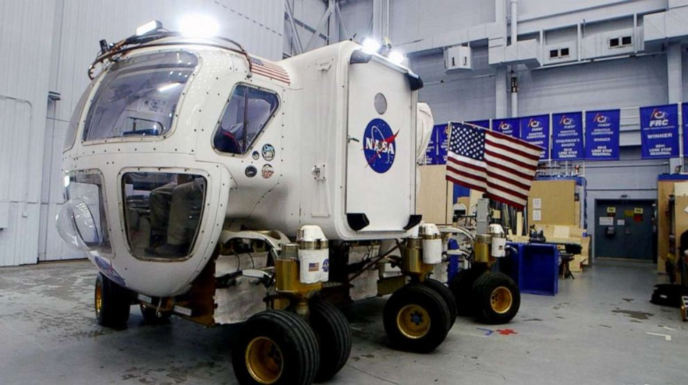 PHOTO: Lucien Junkin, NASA Johnson Space Centers chief engineer for the Space Exploration Vehicle, demonstrates how to maneuver the planetary rover.
