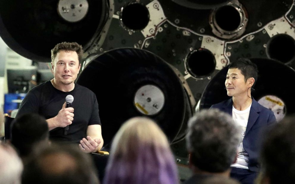 PHOTO: SpaceX founder and chief executive Elon Musk, left, announces Japanese billionaire Yusaku Maezawa, right, as the first private passenger on a trip around the moon, on Sept. 17, 2018, in Hawthorne, Calif.