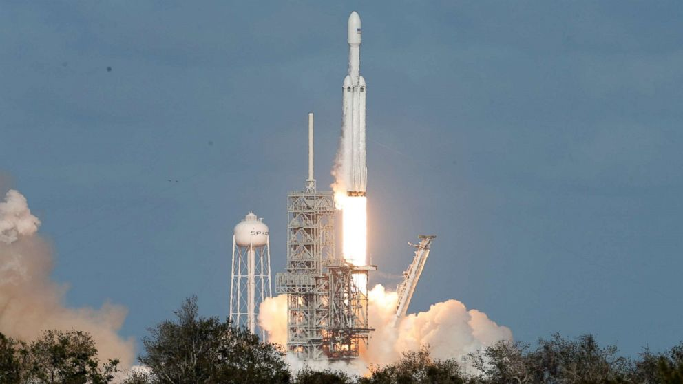 Elon Musk's SpaceX launches megarocket with his own Tesla ...