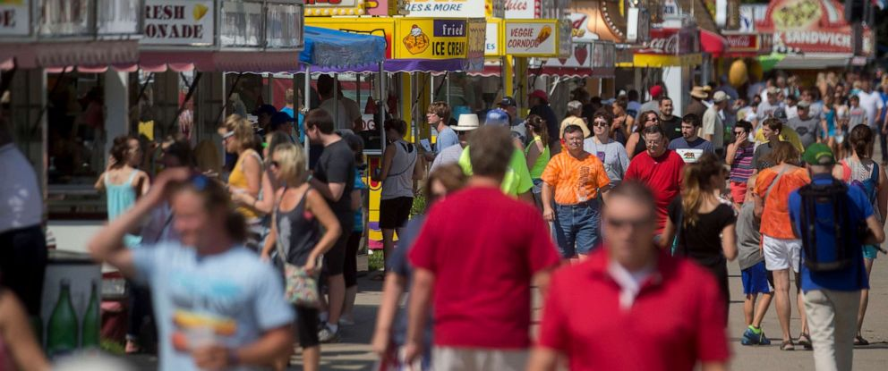 PHOTO: Attendees walk on the Grand Avenue concourse past food stands at the Iowa State Fair in Des Moines, Iowa, Aug. 13, 2015.