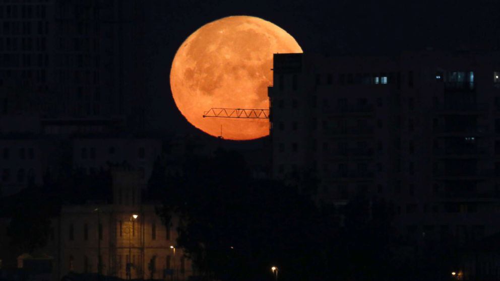 A Super moon rises above the old city of Jerusalem, Jan. 31, 2018.