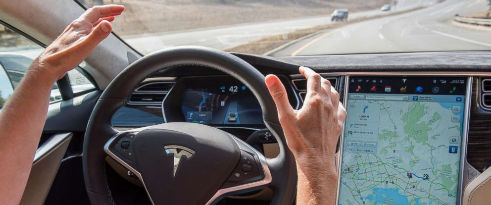 PHOTO: In this file photo dated Oct. 14, 2015, a member of the media test drives a Tesla Motors Inc. Model S car equipped with Autopilot in Palo Alto, Calif.