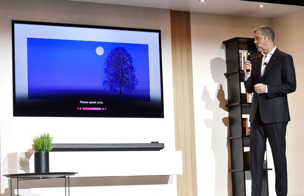 PHOTO: LG Electronics U.S.A. Vice President of Marketing David VanderWaal shows features of the LG AI Signature OLED television during a LG press event for CES 2018 in Las Vegas, Jan. 8, 2018.