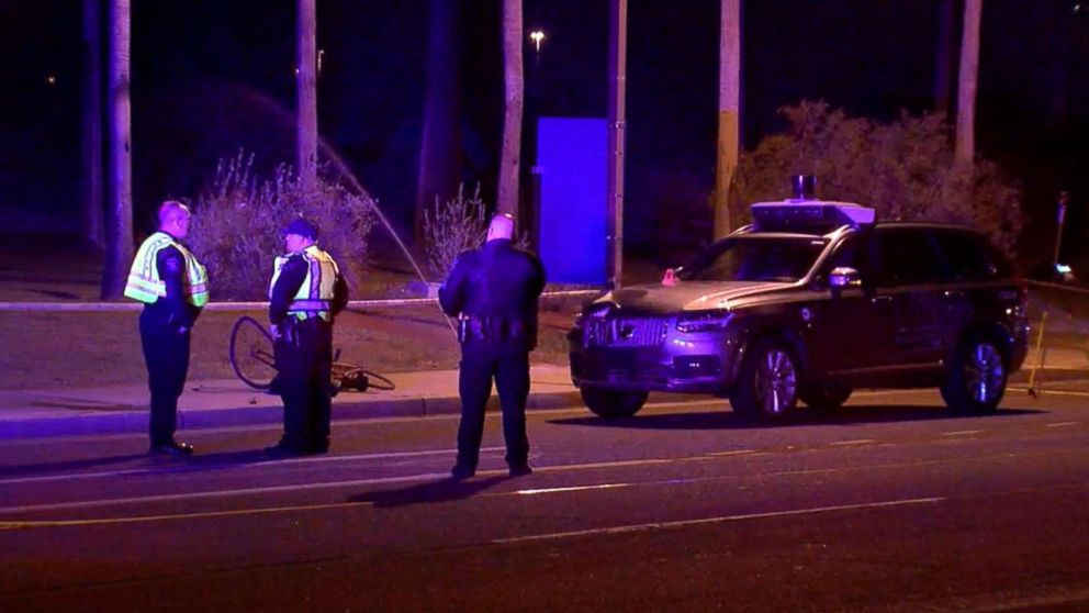 Phoenix police investigate the scene where an Uber self-driving vehicle struck a woman in Tempe, Ariz., March 19, 2018.