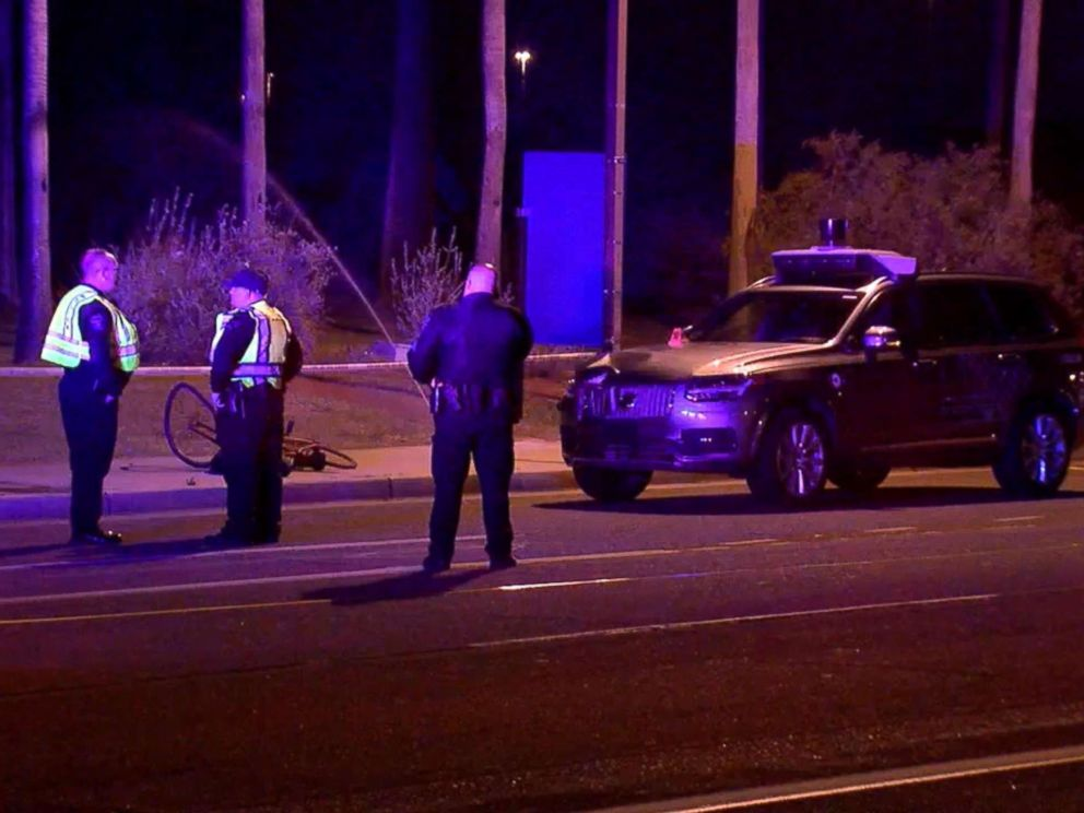 PHOTO: Phoenix police investigate the scene where an Uber self-driving vehicle struck a woman in Tempe, Ariz., March 19, 2018.