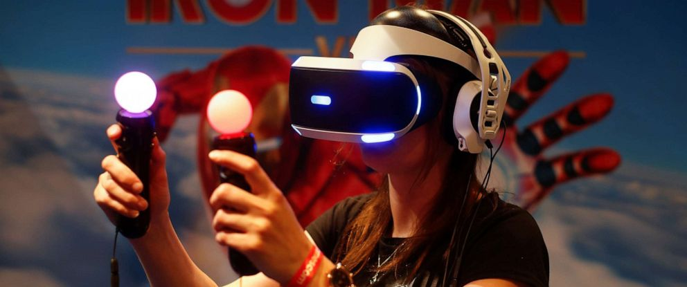 PHOTO: A gamer plays on a Playstation VR with virtual reality goggles and two controllers during Europes leading digital games fair Gamescom, which showcases the latest trends of the computer gaming scene in Cologne, Germany, August 21, 2019.