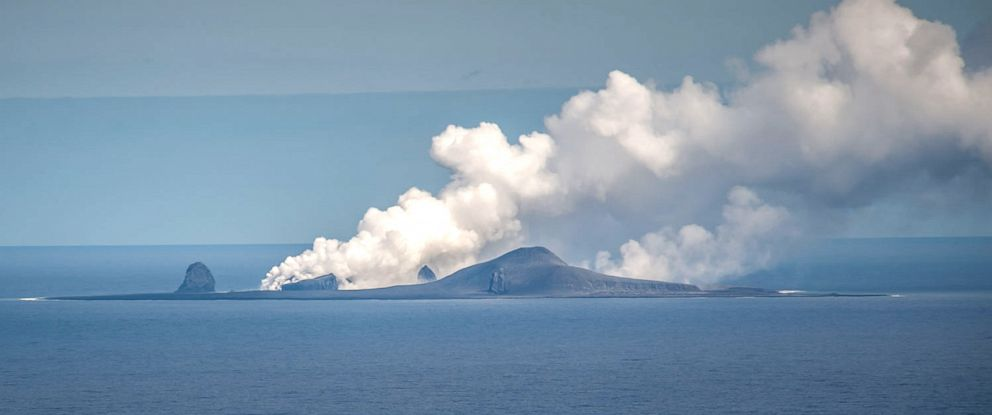PHOTO: A plume of steam flows upward from Bogoslof volcano, a partially submerged volcano that created giant underwater bubbles when it erupted in 2017.