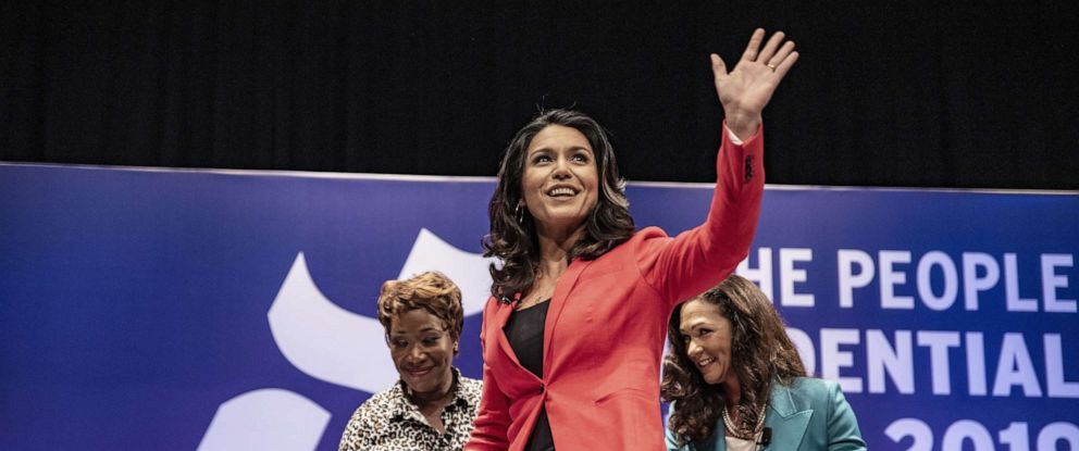 "PHOTO: Democratic presidential candidate Rep. Tulsi Gabbard (D-HI) waves to a crowd at the ""She The People Presidential Forum,"" April 24, 2019, in Houston, Texas."