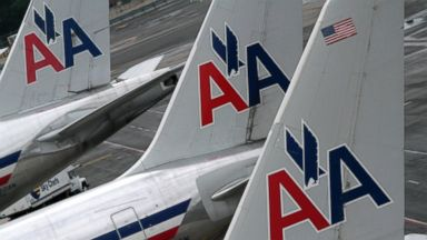 PHOTO:American Airlines airplanes are at parked at the gate at JFK International airport in this file photo, Aug.1, 2012, in New York.